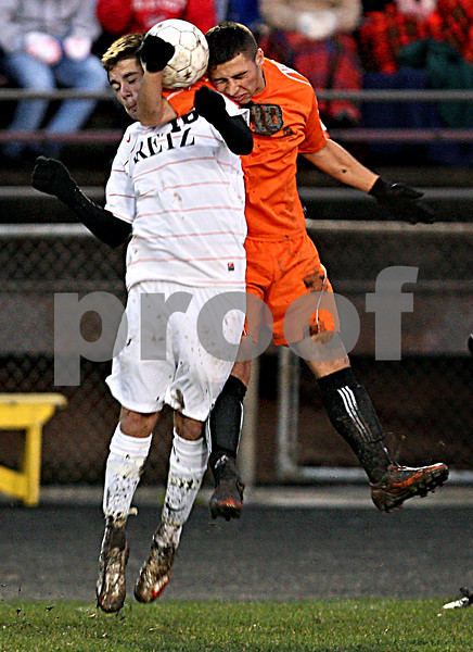 Rob Winner – rwinner@daily-chronicle.com<br /> In the first half, Freeport's Jeremy Willis (left) and DeKalb's Eric Galvan go up for a ball during the IHSA Class 2A Freeport Sectional at Belvidere on Friday October 30, 2009. DeKalb lost to Freeport, 1-0.