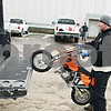 "Beck Diefenbach  -  bdiefenbach@daily-chronicle.com<br /> <br /> Radko Tomko, of Elgin, lift's his 5 year old son's motor cross motorcycle into the back of his truck after riding at Waterman International Raceway in Waterman, Ill., on Tuesday Feb. 17, 2009. Tomko believes that an exception should be made for motorcross in respect to the new lead laws. ""The kids are the future of this sport,"" Tomko said."