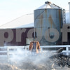 Beck Diefenbach  -  bdiefenbach@daily-chronicle.com<br /> <br /> Amy Klink's, owner of JAK Ranch, searches for loose metal left in the remains of her horse barn which burned down Thursday on her family's ranch in Clare, Ill., on Friday Feb. 6, 2009. Charred nails, bridals and other metal objects are littered through out the area.