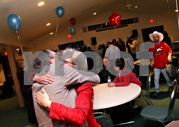 Beck Diefenbach  -  bdiefenbach@daily-chronicle.com<br /> <br /> Acting Mayor Kris Povlsen embraces his wife Jenine at River Heights Golf Club in DeKalb, Ill., on Tuesday April 7, 2009.