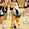 Beck Diefenbach  -  bdiefenbach@daily-chronicle.com<br /> <br /> Sycamore's Justine Schepler (8) is welcomed to the court before her team's  match against Geneva High School in Sycamore, Ill., on Thursday Sept. 17, 2009. Geneva beat Sycamore 2-0.