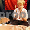 Beck Diefenbach  -  bdiefenbach@daily-chronicle.com<br /> <br /> Jacob Hansen, 10, prays before band practice at the Salvation Army in DeKalb, Ill., on Wednesday Sept. 23, 2009.