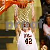 Beck Diefenbach  -  bdiefenbach@daily-chronicle.com<br /> <br /> DeKalb's Jordan Threloff (42) dunks the ball during the third quarter of the game against Chicago Vocational at DeKalb High School in DeKalb, Ill., on Wednesday Dec. 23, 2009.