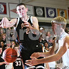 Beck Diefenbach  -  bdiefenbach@daily-chronicle.com<br /> <br /> DeKalb forward Matt Larson (21) loses the ball while guarded by Kaneland center Christian Dillon (50) during the first quarter of the game at Kaneland High School in Maple Park, Ill., on Friday Jan. 23, 2009.