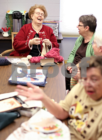 "Beck Diefenbach  -  bdiefenbach@daily-chronicle.com<br /> <br /> Mary Evers (top left), shares a laugh with Joann Faulhaber, both of Genoa, during a knitting session as part of ""compassionate ministries"" at St. Catherine of Genoa Church on Tuesday Nov. 17, 2009."