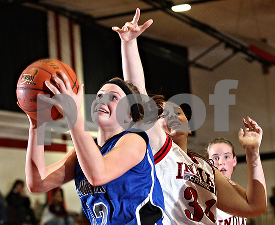 Beck Diefenbach  -  bdiefenbach@daily-chronicle.com<br /> <br /> Newark's Katie Larson (12, left) shoots the ball ahead of Indian Creek's Anna Ostrander (34) during the second half of the game at Indian Creek High School in Shabbona, Ill., on Monday Nov. 30, 2009. Newark defeated Indian Creek 59 to 40.