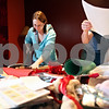 Beck Diefenbach  -  bdiefenbach@daily-chronicle.com<br /> <br /> Northern Illinois University students  Cindy Hammil, left, and Jay Mayer sift through Feb. 14th photographs and letters for a scrap book to be made at the Lutheran Campus Ministry in DeKalb, Ill., on Thursday Feb. 14, 2009.