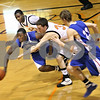 Beck Diefenbach  -  bdiefenbach@daily-chronicle.com<br /> <br /> DeKalb's Grant Olsen (34) and Glenbard South's Louis Erkins (32) leap for a loose ball during the third quarter of the game at DeKalb High School in DeKalb, Ill., on Friday Feb. 13, 2009.