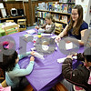Rob Winner – rwinner@daily-chronicle.com<br /> Circulation clerk Darcy Tatlock teaches a group of children how to make a holiday cracker filled with confetti to celebrate the new year at the DeKalb Public Library in DeKalb, Ill. on Thursday December 31, 2009.