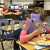 Beck Diefenbach  -  bdiefenbach@daily-chronicle.com<br /> <br /> 6th grader Miranda Wells eats cake in celebration of Louis Braille's 200th birthday during the Braille Club meeting at Sycamore Middle School in Sycamore, Ill., on Thursday Jan. 22, 2008.