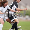 Beck Diefenbach  -  bdiefenbach@daily-chronicle.com<br /> <br /> Sycamore's Karissa Miller (10) and Kaneland's Amy Fabrizius (18) battle for the ball  during the second half of the game at Sycamore High School in Sycamore, Ill., on Friday May 7, 2009. Sycamore beat Kaneland 3 to 0.