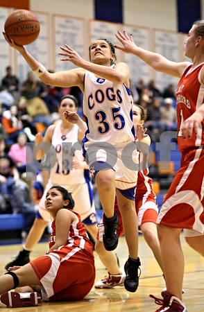 Beck Diefenbach  -  bdiefenbach@daily-chronicle.com<br /> <br /> Genoak-Kingtson's Alexis Carroll (35, center) shoots the ball as Mooseheart's Santanna Sanchez (33, bottom) watches from the ground during the second quarter of the final game in the G-K Christmas Tournament at G-K High School in Genoa, Ill., on Wednesday Dec. 16, 2009.