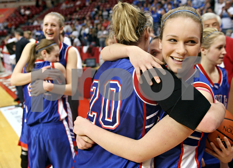 Beck Diefenbach – bdiefenbach@daily-chronicle.com<br /> <br /> Hinckley-Big Rock's Katie Hollis (right) hugs Jenna Thorp following their win over Winchester West Central High School in the Class 1A IHSA State Basketball Championships at the Red Bird Arena in Normal, Ill., on Saturday Feb. 28, 2009.
