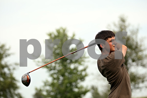 Beck Diefenbach  -  bdiefenbach@daily-chronicle.com<br /> <br /> DeKalb senior Andrew Morreale tees off during practice at River Heights Golf Course in DeKalb, Ill., on Tuesday Aug. 25, 2009.