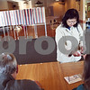 Beck Diefenbach  -  bdiefenbach@daily-chronicle.com<br /> <br /> Jean Bednarz, of DeKalb, receives her voting receipt before voting at the DeKalb Elks Club in DeKalb, Ill., on Tuesday April 7, 2009.
