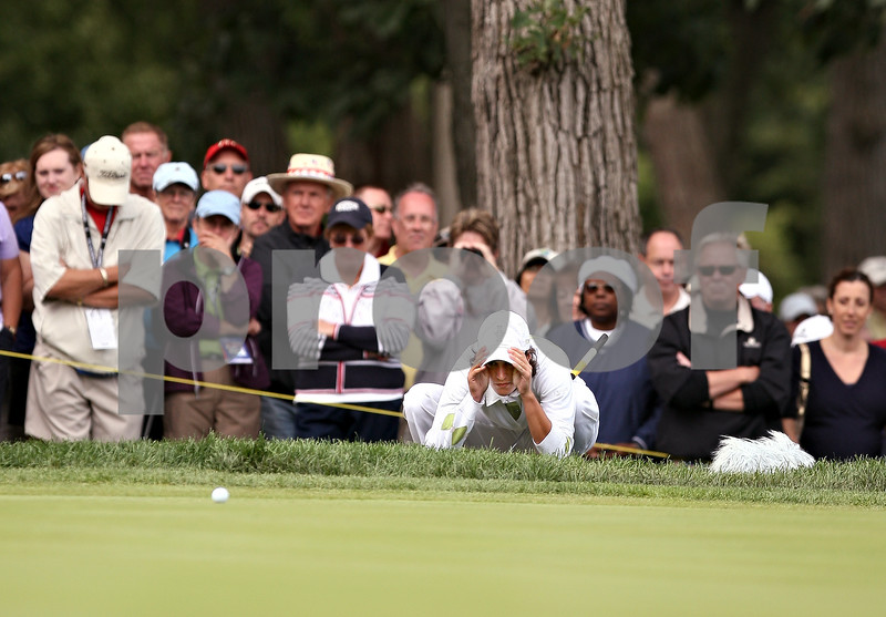 Beck Diefenbach  -  bdiefenbach@daily-chronicle.com<br /> <br /> Europe's Tania Elosegui inspects the 7th hole green during the match against team USA at the Solheim Cup in Sugar Grove, Ill., on Saturday Aug. 22, 2009.