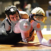 Beck Diefenbach  -  bdiefenbach@daily-chronicle.com<br /> <br /> Kaneland's Mark Southern controls DeKalb's Coltin Phelps during the 140-pound match at DeKalb High School in DeKalb, Ill., on  Friday Dec. 11, 2009.