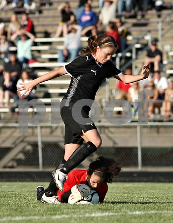 Beck Diefenbach  -  bdiefenbach@daily-chronicle.com<br /> <br /> Sycamore's Karissa Miller (10) nearly kicks Freeport goalie Becca Ursin during the first half of the IHSA Class 2A Sectional final game at Belvidere High School in Belvidere, Ill., on Friday May 29, 2009.