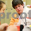 Beck Diefenbach  -  bdiefenbach@daily-chronicle.com<br /> <br /> Emily Lampkin, right, pours juice for her classmate Laura Bosshardt during lunch at Life School Transition Program in Sycamore, Ill., on Tuesday Feb. 10, 2009. The program is meant to help disabled adults prepare for life on their own.