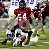 Rob Winner –  rwinner@daily-chronicle.com<br /> In the second half, Northern's Jake Coffman (54) sacks Western quaterback Wil Lunt, as Northern Illinois defeated Western Illinois 41-7 in DeKalb on Saturday night.<br /> 09/12/2009