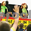 Beck Diefenbach  -  bdiefenbach@daily-chronicle.com<br /> <br /> Students raise their hands to ask questions about autism following a puppet show about learning disabilities performed by Sycamore High School students at Southeast Elementary School in Sycamore, Ill., on Thursday May 14, 2009.