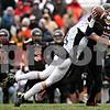 Rob Winner - rwinner@daily-chronicle.com<br /> <br /> Kaneland's Taylor Andrews sacks DeKalb quarterback Dylan Donnelly during the second quarter.<br /> <br /> 10/10/2009