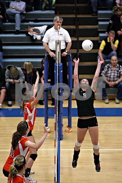 Rob Winner – rwinner@daily-chronicle.com<br /> Jessica Lubic (9) sets a ball for Kaneland teammate Katy Dudzinski (not pictured) during their second game against DeKalb on Thursday night at Burlington Central.<br /> 10/29/09