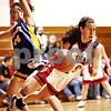 Beck Diefenbach  -  bdiefenbach@daily-chronicle.com<br /> <br /> Indian Creek's Anna Stiker (10, right) trips over Somonauk's Karrah Kuykendall (44) during the second quarter of the game at Indian Creek High School in Shabbona, Ill., on Thursday Dec. 10, 2009. Somonauk came back from behind to defeat Indian Creek 49 to 47.