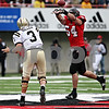 Rob Winner – rwinner@daily-chronicle.com<br /> During the first half, Western Michigan quarterback Tim Hiller is pressured by defensive end Jake Coffman. Hiller's pass was picked off by Kiaree Daniels of the Huskies. Northern Illinois went on to defeat Western Michigan 38-3 on Saturday.<br /> 10/03/2009