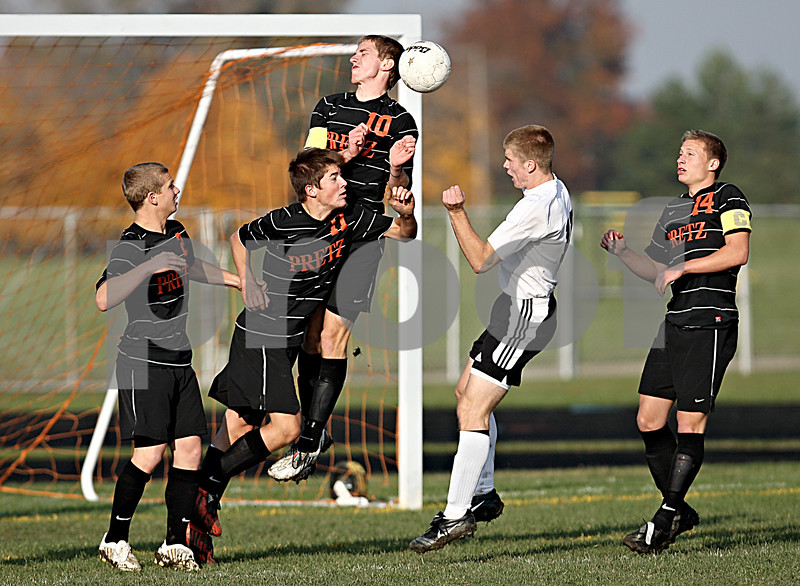 Rob Winner – rwinner@daily-chronicle.com<br /> Mark Persson (second from the right) tries to put one past four Freeport defenders in the first half during the IHSA Class 2A Freeport Sectional semifinal in Belvidere on Tuesday October 27, 2009.