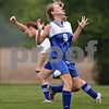 Beck Diefenbach  -  bdiefenbach@daily-chronicle.com<br /> <br /> Westminster's Katie Webster (9) reacts after Genoa's Kathryn Graff (9) scored the team's first goal during the during the first half of the Class 1A Elgin Westminster Christian regional quarter final game at Genoa-Kingston High School in Genoa, Ill., on Wednesday May 13, 2009.