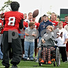 Amanda Luchsinger passes the ball to NIU Football's Donald Smith during the Huskies' annual meeting with Special Olympics athletes on Sunday, October 4, 2009 in Dekalb. (Marcelle Bright/for the Daily Chronicle)