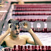 Rob Winner – rwinner@daily-chronicle.com<br /> Rob Winner – rwinner@kcchronicle.com<br /> Kaneland senior Grant Alef takes a break for a moment while swimming laps at the Kishwaukee Family YMCA in DeKalb, Ill. on Wednesday December 23, 2009.