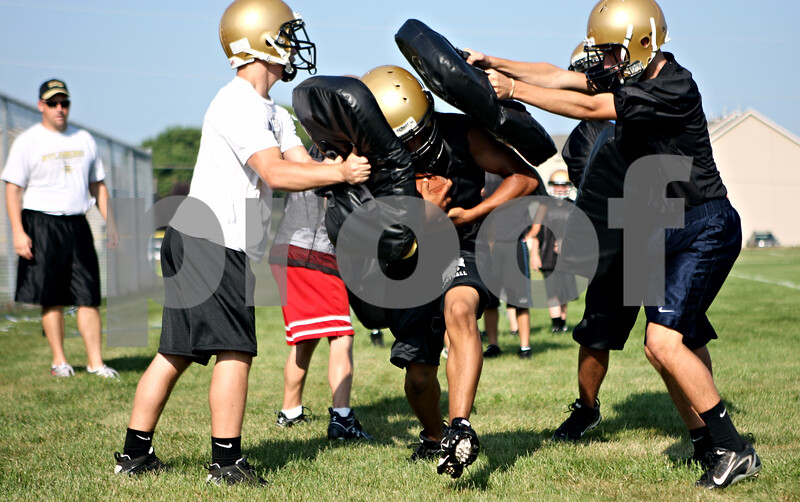 Rob Winner – rwinner@daily-chronicle.com<br /> Trent Greer participates in a running back drill during the first day of practice at Sycamore High School on Wednesday morning.<br /> 08/12/2009