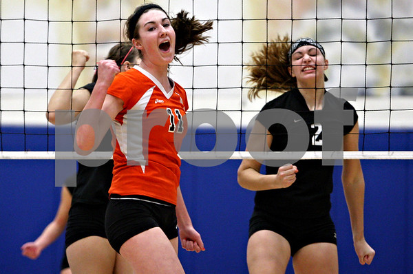 Rob Winner – rwinner@daily-chronicle.com<br /> DeKalb's Emily Bemis (11) celebrates after one of her kills past Kaneland's Katy Dudzinski (2) in the first game during the Class 3A Burlington Central Regional on Thursday October 29, 2009.