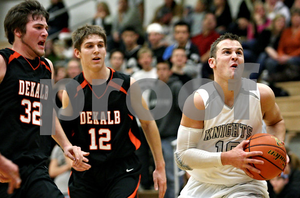 Rob Winner – rwinner@daily-chronicle.com<br /> Rob Winner – rwinner@kcchronicle.com<br /> Kaneland's Ryley Bailey heads for the basket during the second quarter.<br /> 12/04/2009