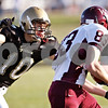 Beck Diefenbach  -  bdiefenbach@daily-chronicle.com<br /> <br /> Sycamore linebacker Jordan Kalk (10, left) tackles Wheaton Academy wide receiver Jimmy Johnson (83) during the fourth quarter of the game at Sycamore High School in Sycamore, Ill., on Saturday Nov. 7, 2009. Sycamore defeated Wheaton Academy 42 to 0.