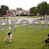 Beck Diefenbach  -  bdiefenbach@daily-chronicle.com<br /> <br /> Krystal Wilson, 11, chases her service dog, Bella, on the lawn of her Cortland home on Friday May 29, 2009.