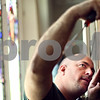Beck Diefenbach  -  bdiefenbach@daily-chronicle.com<br /> <br /> Organ service technician Stephan Drexler, of Berghaus Pipe Organ Builders, replaces the cover after making adjustments to the organ at St. Mary's of the Assumption Church in Maple Park, Ill., on Friday March 20, 2009. Drexler was tuning the organ in preparation of the future performance.