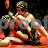 Rob Winner – rwinner@daily-chronicle.com<br /> Rob Winner – rwinner@kcchronicle.com<br /> Batavia's Jake Schulz (left) tries to himself from the grasp of DeKalb's Doug Johnson during their match on Thursday night in Batavia.<br /> 12/03/2009 <br /> 119 lbs.<br /> Johnson wins