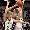 Beck Diefenbach – bdiefenbach@daily-chronicle.com<br /> <br /> Hinckley-Big Rock forward Tess Godhardt attempts to shoot the ball over Winchester West Central McKea Fisher(24) during the third quarter of the Class 1A State Championship at the Redbird Arena in Normal, Ill., on Saturday Feb. 28, 2009.