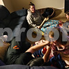 Beck Diefenbach  -  bdiefenbach@daily-chronicle.com<br /> <br /> Deb Edwards (top center) watches two of her daughters Amanda, 16, left, and Jada 8, tussle on the couch after wrapping presents at their new home in DeKalb, Ill.,  on Monday Dec. 21, 2009. The Edwards family moved into their home just a week ago.