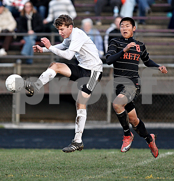 Rob Winner – rwinner@daily-chronicle.com<br /> Sycamore's Adam Westerby tries to control a ball in front of Freeport's Mike Gordon during the IHSA Class 2A Freeport Sectional semifinal in Belvidere on Tuesday October 27, 2009.