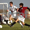 Beck Diefenbach  -  bdiefenbach@daily-chronicle.com<br /> <br /> Genoa-Kingston's Ryan Munch (34, left) and Northridge's Luke Diffenthallar (20) battle for the ball during first half of the regional playoff game at GK High School in Genoa, Ill., on Tuesday Oct. 13, 2009. After two overtime periods, the game was suspended due to darkness and will be restarted on Thursday at 4:30 P.M. at Genoa-Kington High School.
