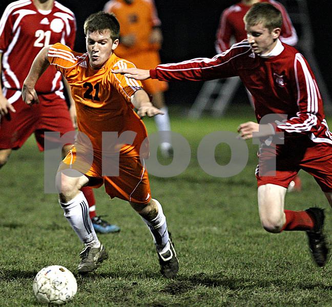 Rob Winner – rwinner@daily-chronicle.com<br /> DeKalb's Cory Filkins moves through Marian defenders during the first half.