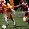 Rob Winner – rwinner@daily-chronicle.com<br /> DeKalb's Cory Filkins moves through Marian defenders during the first half.