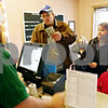"Rob Winner – rwinner@daily-chronicle.com<br /> Andrew Anderson (from left to right), of Maple Park, purchases tickets to see ""Alvin and the Chipmunks: The Squeakquel"" for his family, which includes Kendall, 10, wife Amy, and Kelsey, 6, at the Sycamore State Street Theatre in Sycamore, Ill. on Friday December 25, 2009."