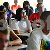 Rob Winner – rwinner@daily-chronicle.com<br /> Incoming freshman Karina Montes, 14, listens to a DeKalb High School educator during orientation on Tuesday morning.<br /> 08/11/2009