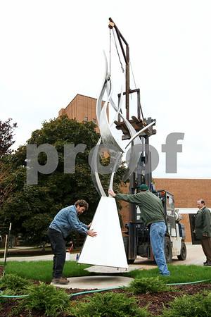"Rob Winner – rwinner@daily-chronicle.com<br /> ""Remembered,"" a sculpture by NIU alumnus Bruce Niemi was placed in front of Cole Hall on Thursday morning.<br /> 10/01/2009"