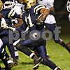 Beck Diefenbach  -  bdiefenbach@daily-chronicle.com<br /> <br /> Hiawatha Angel Hernandez (11) rushes with the ball before one of his touchdowns during the first quarter of the game against University of Chicago Charter School-Woodlawn at Hiawatha High School in Kirkland, Ill., on Friday Oct. 9, 2009.